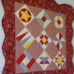 Red Sampler Quilt with Scalloped Border