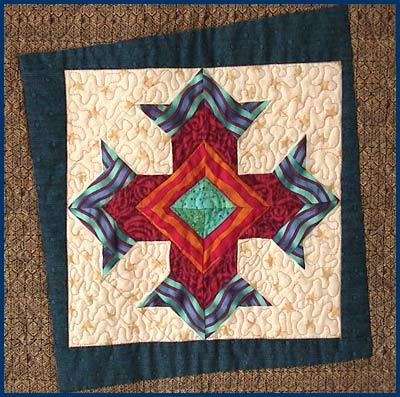 god eye cross sampler quilt